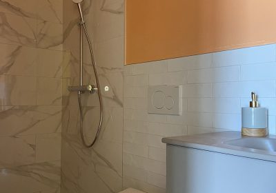 The beautiful bathroom with a peach colour which will make you even look more tanned.