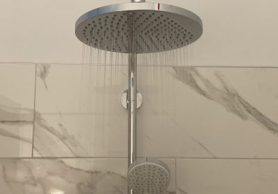 "Enjoy a lovely ""rain"" shower after a long day of relaxing."