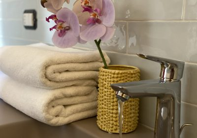 All of our bathrooms have their own colour of tiles combined with the best accessories.